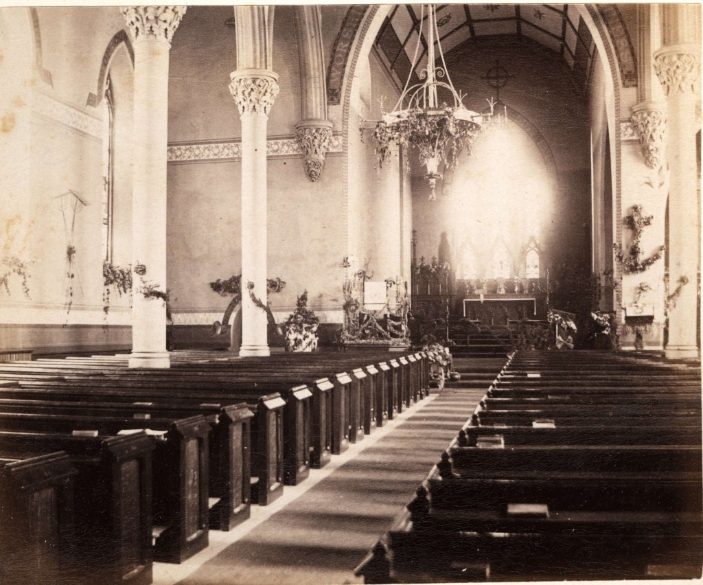 The earliest photograph, about 1875, of the interior of St Paul's Church by photographer James W. Powell from his studio album that he used to advertise the diversity and quality of his photographic work. (Queen's University Archives)